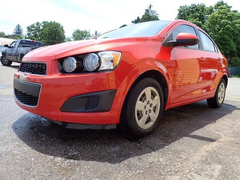 2013 CHEVROLET SONIC LS AUTO 4DR SEDAN orange door handle color - body-color exhaust tip color -