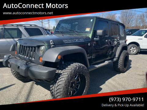 2011 Jeep Wrangler Unlimited Sport for sale at AutoConnect Motors in Kenvil NJ