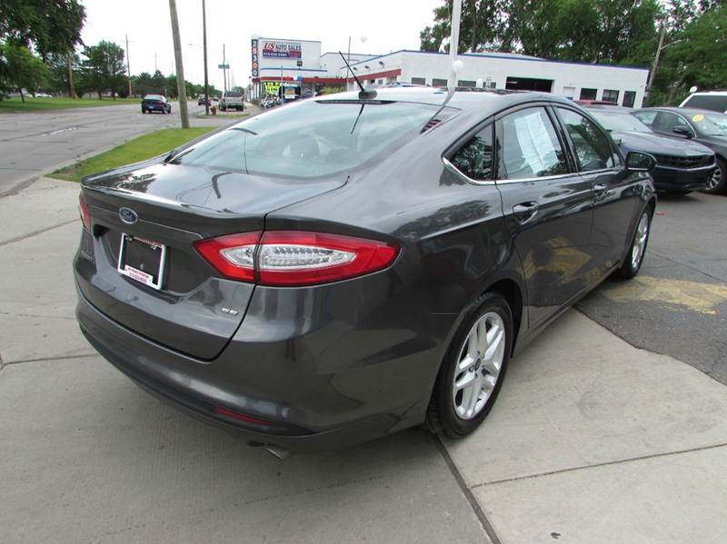 2015 Ford Fusion for sale at Twins Auto Sales Inc - Redford Lot in Redford MI