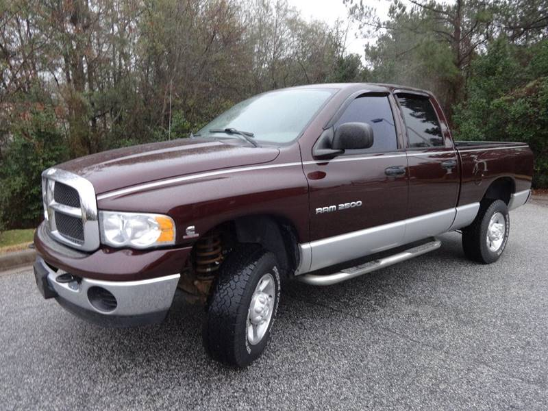 2004 DODGE RAM PICKUP 2500 SLT burgundy this is a completely stock 2004 dodge ram 2500 cummins di