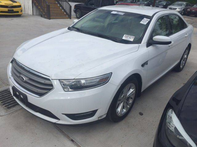 2013 FORD TAURUS SEL 4DR SEDAN white exhaust - dual tip door handle color - body-color exhaust