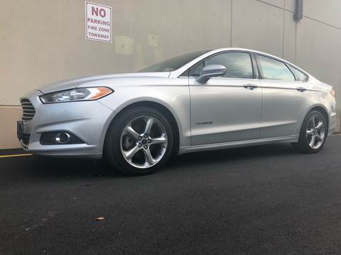 2013 Ford Fusion Hybrid for sale at International Auto Sales in Hasbrouck Heights NJ