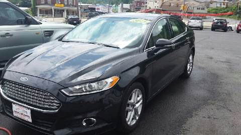 2013 Ford Fusion for sale at Mulligan's Auto Exchange LLC in Paxinos PA