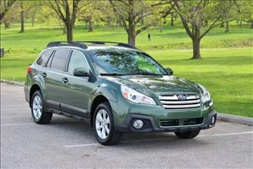 2014 Subaru Outback for sale at UNISELL AUTO in Omaha NE