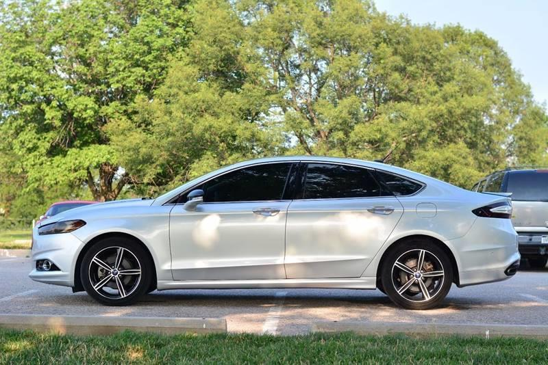 2014 Ford Fusion for sale at UNISELL AUTO in Omaha NE