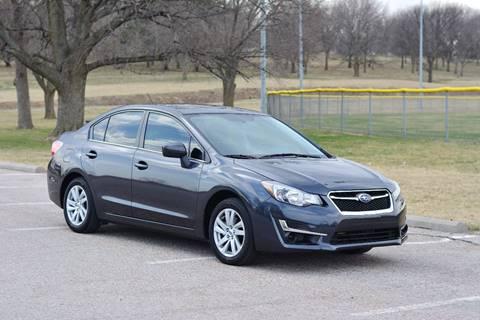 2016 Subaru Impreza for sale at UNISELL AUTO in Omaha NE