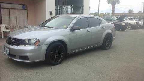 2014 Dodge Avenger for sale at Salas Auto Group in Indio CA