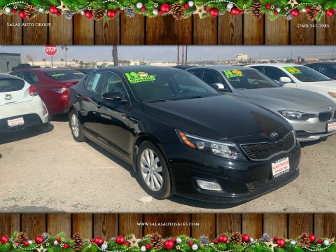 2014 Kia Optima for sale at Salas Auto Group in Indio CA