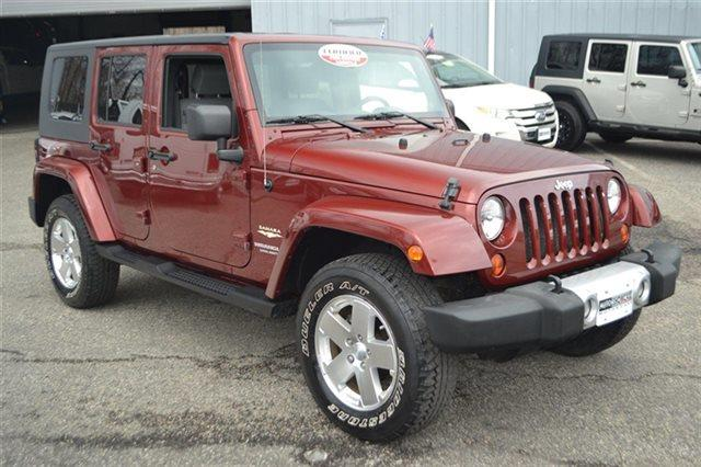 2009 JEEP WRANGLER UNLIMITED SAHARA 4X4 4DR SUV red rock crystal pearl low miles this 2009 jee