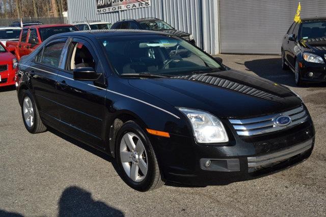 2009 FORD FUSION V6 SE 4DR SEDAN black this 2009 ford fusion 4dr 4dr sedan v6 se fwd features a 3