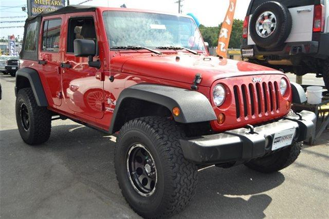 2009 JEEP WRANGLER UNLIMITED X 4X4 4DR SUV red this 2009 jeep wrangler unlimited 4dr 4wd 4dr x fe