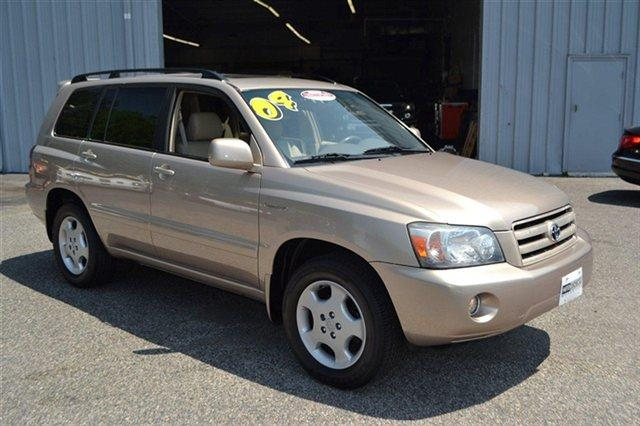 2004 TOYOTA HIGHLANDER 4DR V6 4WD LIMITED W3RD ROW AWD gold this 2004 toyota highlander 4dr v6