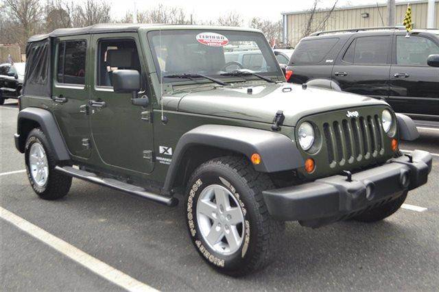 2007 JEEP WRANGLER UNLIMITED X 4DR SUV jeep green metallic low miles this 2007 jeep wrangler un