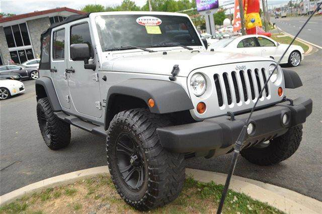 2010 JEEP WRANGLER UNLIMITED SPORT 4X4 4DR SUV bright silver metallic low miles this 2010 jeep