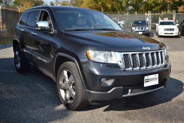 2011 JEEP GRAND CHEROKEE OVERLAND 4WD black this 2011 jeep grand cherokee overland 4wd features a