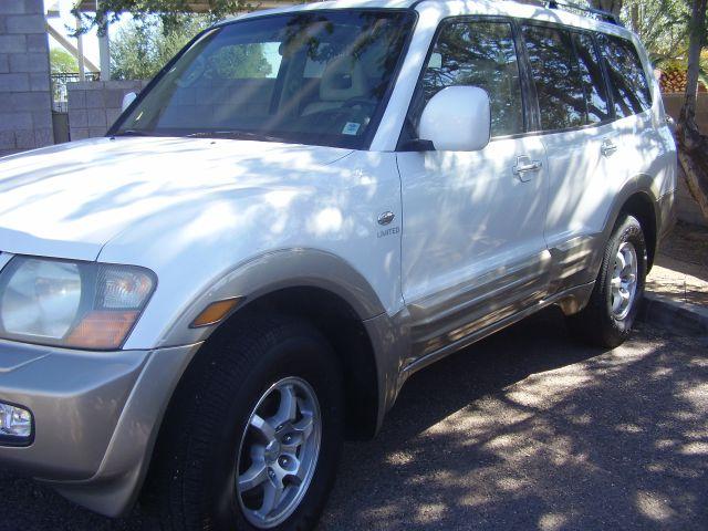 2002 MITSUBISHI MONTERO LIMITED 4WD 4DR SUV white abs - 4-wheel antenna type - power anti-theft