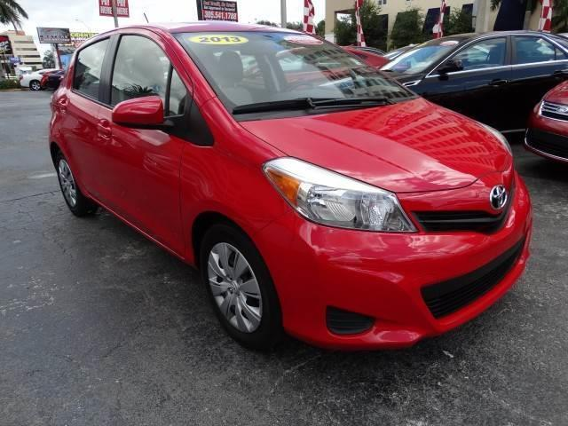 2013 TOYOTA YARIS L HATCHBACK 4D absolutely red front wheel drivepower steeringwheel coverstemp