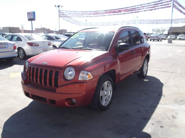 2008 JEEP COMPASS SPORT 2WD orange down payment 2500  excel motors offers an extensive inventory