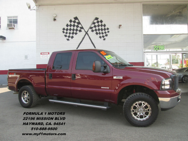 2005 FORD F-250 SUPER DUTY XLT 4DR CREW CAB 4WD LB red abs - 4-wheel axle ratio - 373 bumper co