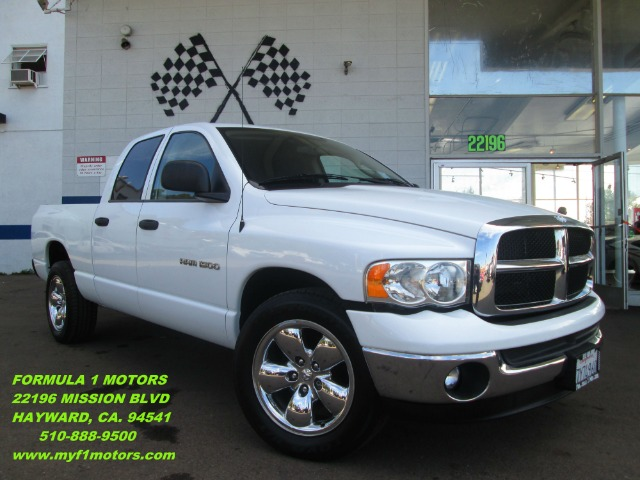 2005 DODGE RAM 1500 SLT QUAD CAB SHORT BED 2WD white this dodge ram 1500 is perfect for what ever