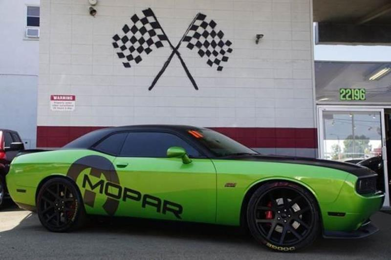 2011 DODGE CHALLENGER SRT8 392 2DR COUPE green with envy this is the muscle-flexing classically