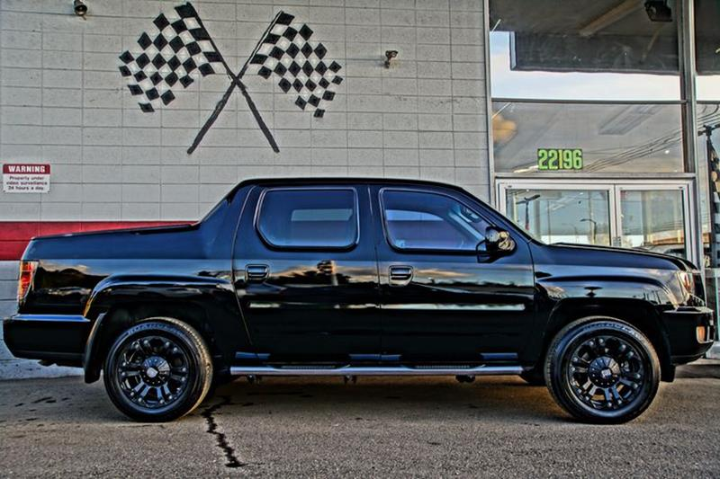 2014 HONDA RIDGELINE SE 4X4 4DR CREW CAB obsidian blue pearl with impressive amenities and luxuri