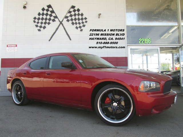 2009 DODGE CHARGER SE 4DR SEDAN red this is a beautiful dodge charger super clean inside and out