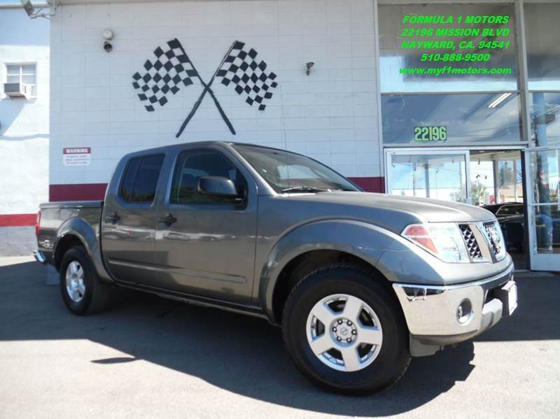 2006 NISSAN FRONTIER SE 4DR CREW CAB SB WAUTOMATIC grey this is a very nice nissan frontier per