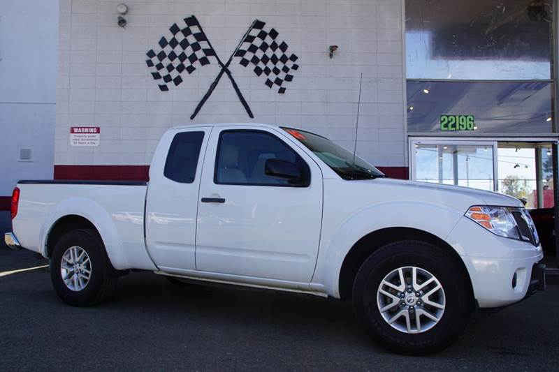 2014 NISSAN FRONTIER SV 4X2 4DR KING CAB 61 FT SB P glacier white 2-stage unlocking doors abs
