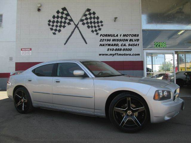 2010 DODGE CHARGER SXT 4DR SEDAN silver this is a super clean dodge charger brand new 22 wheels