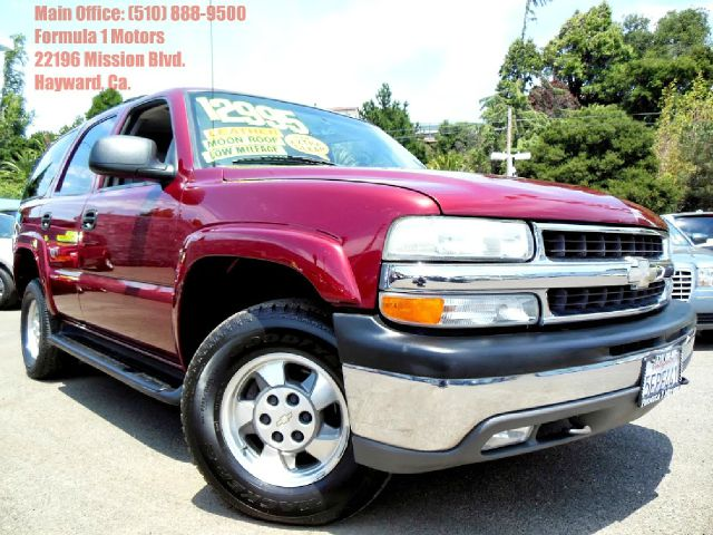 2003 CHEVROLET TAHOE 4WD red 53l v8 automatic 4x4 leather moon roof 3rd row 4wdawdabs brake