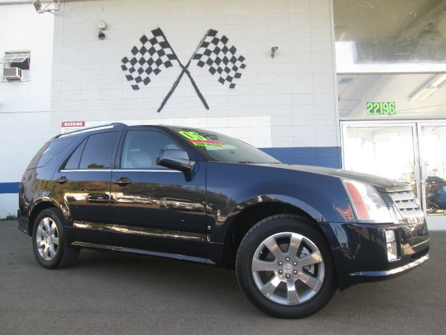 2006 CADILLAC SRX V8 dark blue abs brakesair conditioningalloy wheelsamfm radioanti-brake sys
