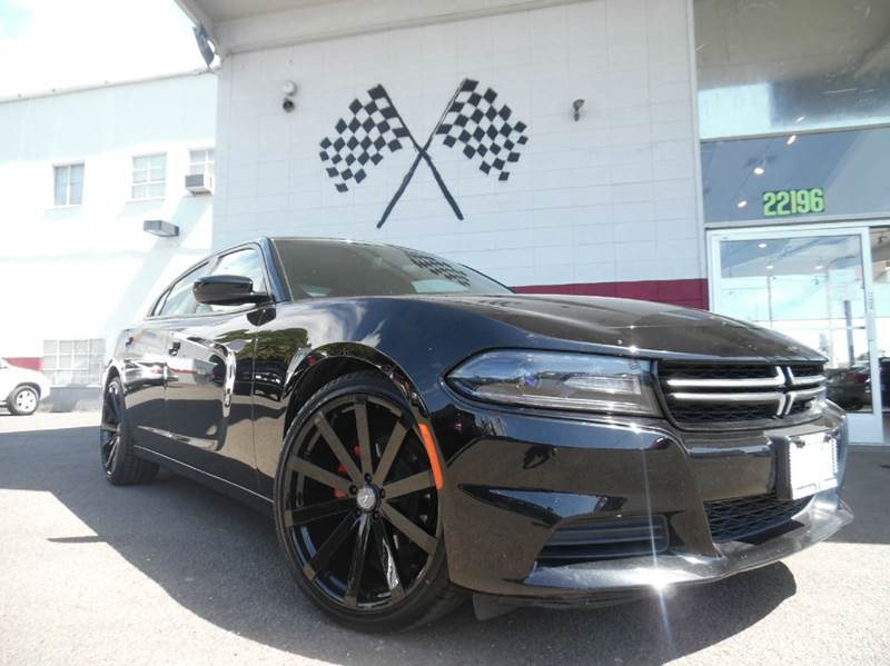 2015 DODGE CHARGER SE 4DR SEDAN black this unit is a beauty great interior design and dashboar