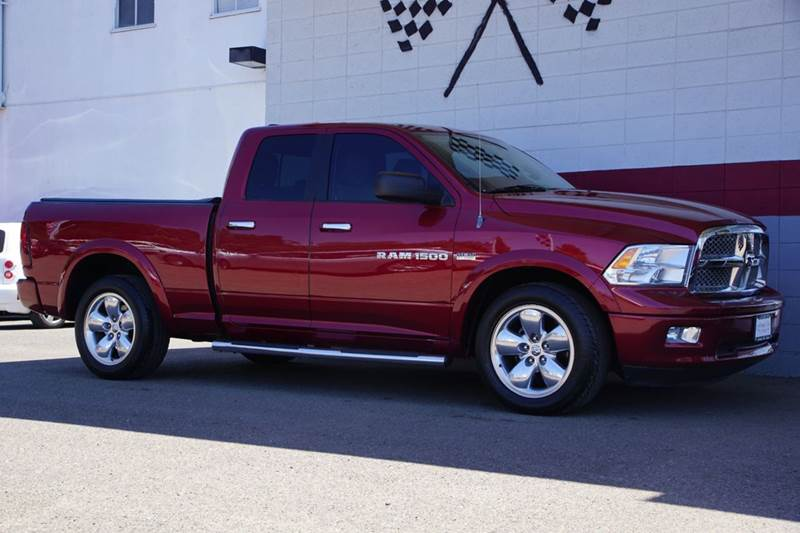 2012 RAM RAM PICKUP 1500 LARAMIE 4X2 4DR QUAD CAB 63 FT deep cherry red crystal pearlc 2-stage u