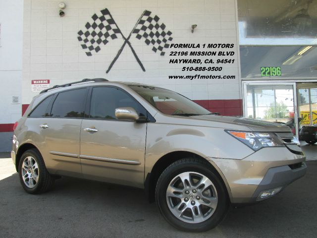 2007 ACURA MDX SH AWD 4DR SUV gold this is a very nice smaller size suv loaded with leather moon