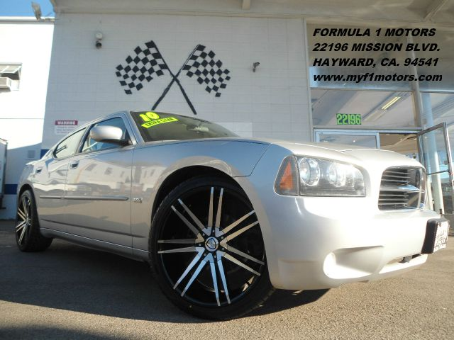 2010 DODGE CHARGER SXT silver equipped with brand new  22 wheels  tires and a matching rear spoil