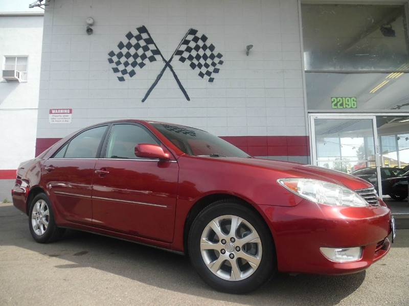 2005 TOYOTA CAMRY LE V6 4DR SEDAN red super clean toyota camry gorgeous leather interior moon r