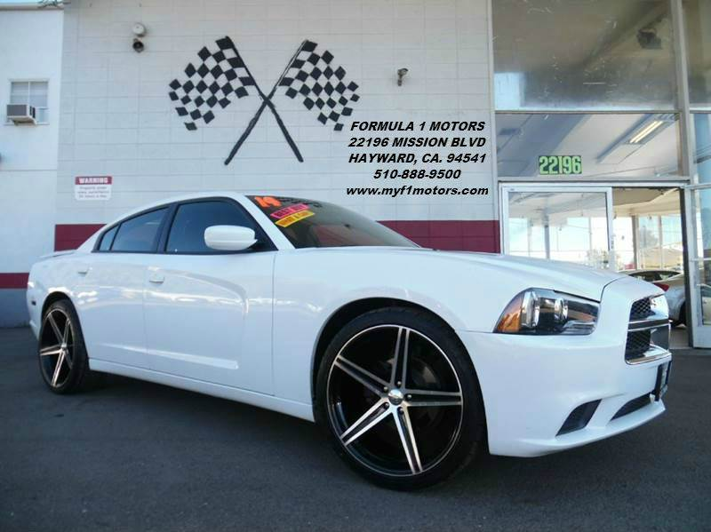 2014 DODGE CHARGER SE 4DR SEDAN white this is a very nice dodge charger brand new wheels and tir