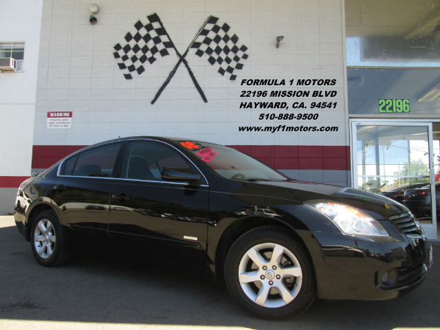 2008 NISSAN ALTIMA HYBRID BASE 4DR SEDAN black this nissan altima is the best commuter  its grea