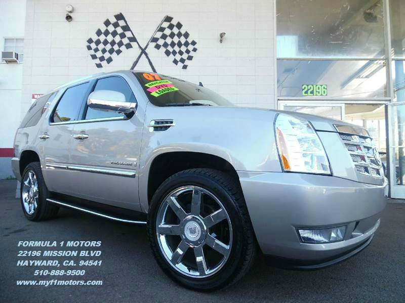 2007 CADILLAC ESCALADE AWD 4DR SUV gold this is a super clean cadillac escalade loaded with leat