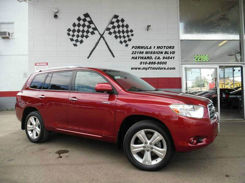 2009 TOYOTA HIGHLANDER LIMITED 4DR SUV red this is a very nice toyota highlander super clean ins