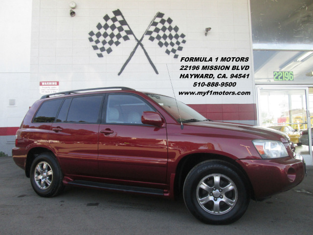 2004 TOYOTA HIGHLANDER BASE FWD 4DR SUV burgundy abs - 4-wheel captain chairs - 2 cassette cent