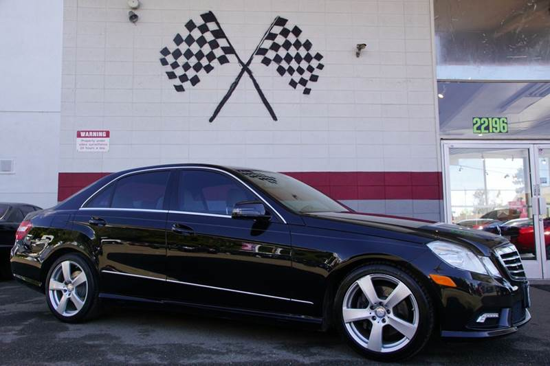 2011 MERCEDES-BENZ E-CLASS E 350 LUXURY 4MATIC AWD 4DR SEDA black 2-stage unlocking doors 4wd ty