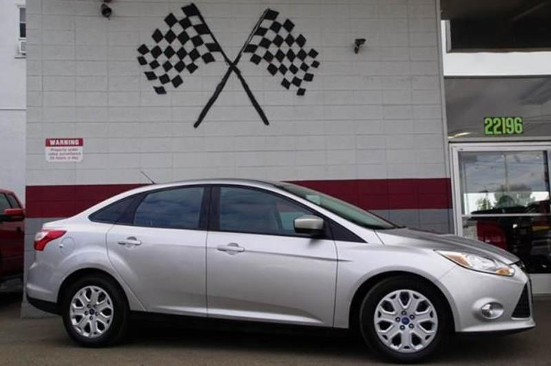 2012 FORD FOCUS SE 4DR SEDAN ingot silver metallic say hello to our fun to drive 2012 ford focus