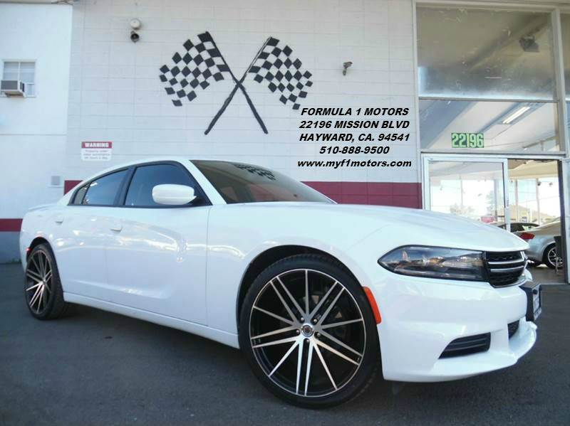 2015 DODGE CHARGER SE 4DR SEDAN white this dodge charger is in perfect condition looks gorgeous i