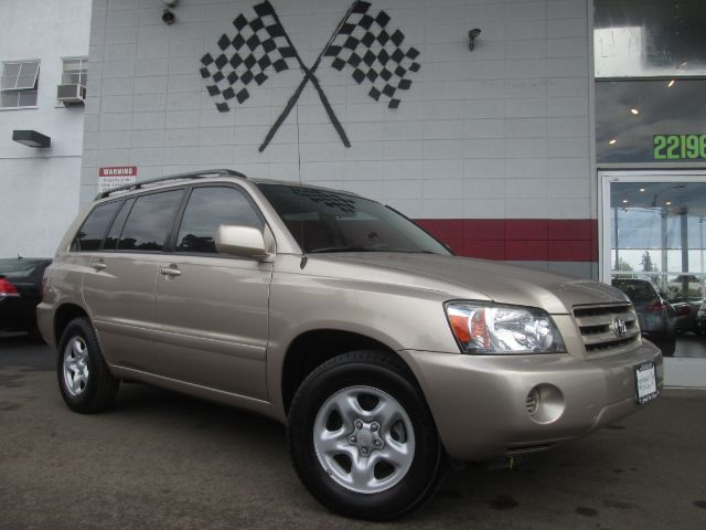 2007 TOYOTA HIGHLANDER 4DR SUV W3RD ROW gold 2-stage unlocking - remote abs - 4-wheel air filt