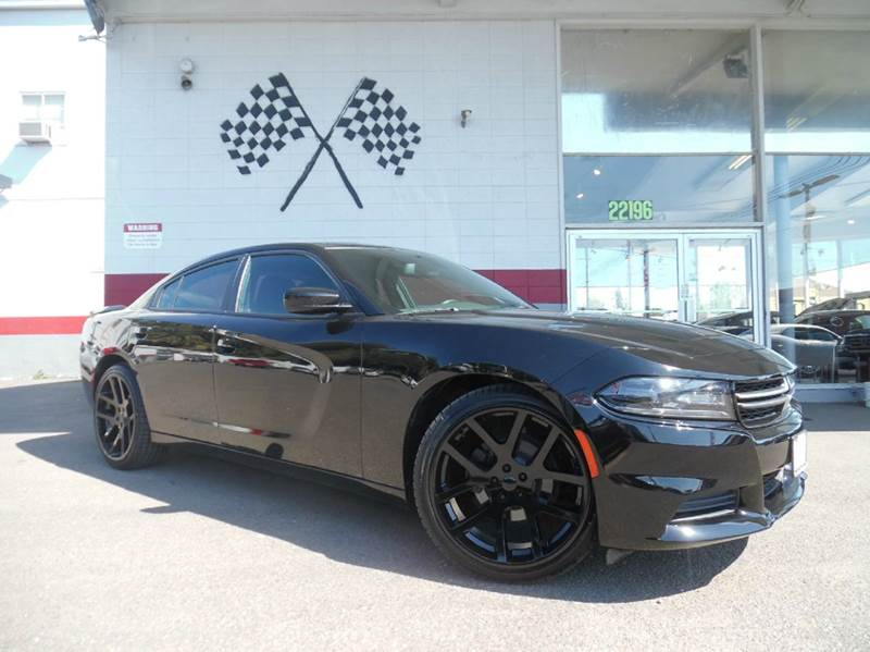 2015 DODGE CHARGER SE 4DR SEDAN black this unit is great runs really smooth and has a great sou