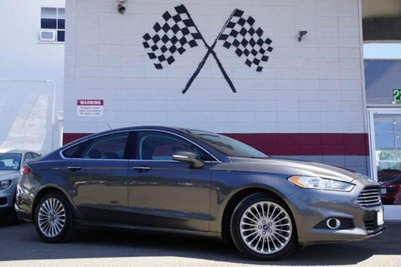 2015 FORD FUSION TITANIUM 4DR SEDAN magnetic experience the bold style and powerful presence of o