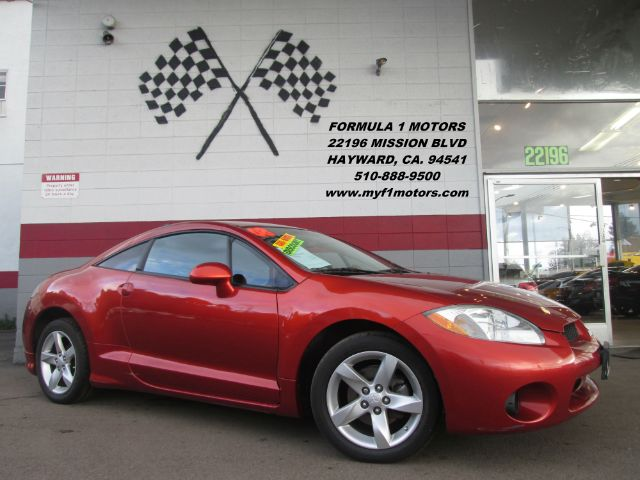 2008 MITSUBISHI ECLIPSE GS HATCHBACK orange great car sporty loaded with a moon roof and a sub