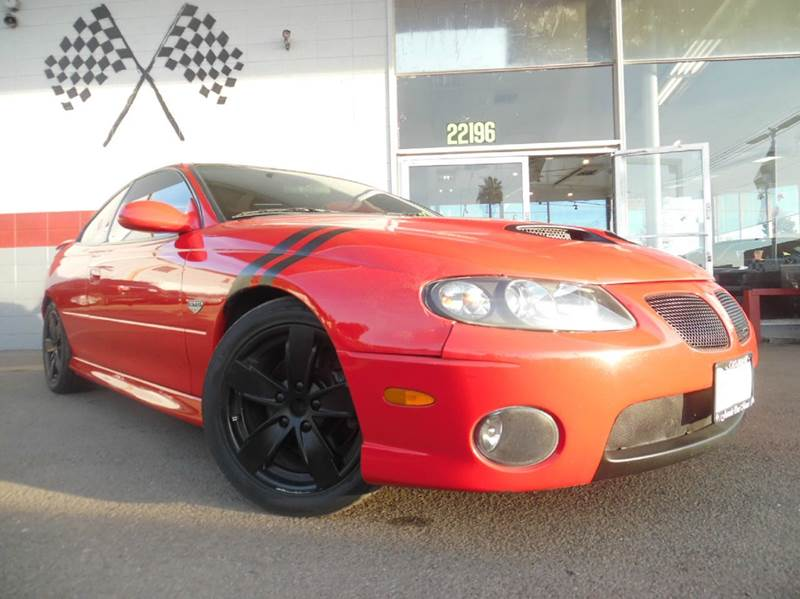 2005 PONTIAC GTO BASE 2DR COUPE red gorgeous sounding engine with a great exterior amazing acc